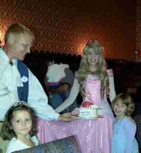 The birthday girl with her Aurora themed cake (allergy-free recipe, get to pick your princess, balloon, card signed by the princesses and mini tiara for $85 + tax). At Cinderella's Royal Table. Fun to have Aurora visit when cake was presented. Also, this server, Ray, was amazing. Best server we had at Disney and honestly one of the best I've had ever. Give him a raise!!