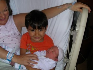 Emre with his infant brother