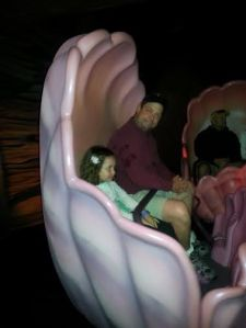 Ride in a clam shell during the Under the Sea ride