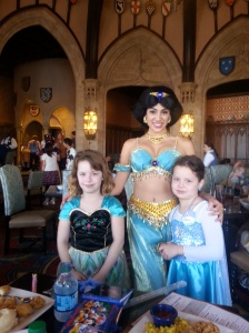 Meeting Jasmine at Cinderella's Royal Table. Cinderella greets you as you enter the castle then you go upstairs to eat and get visited by multiple princesses at your table.