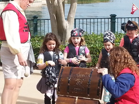 Discovering treasure at the end of a two-hour, kid-only pirate cruise at the Grand Floridian.