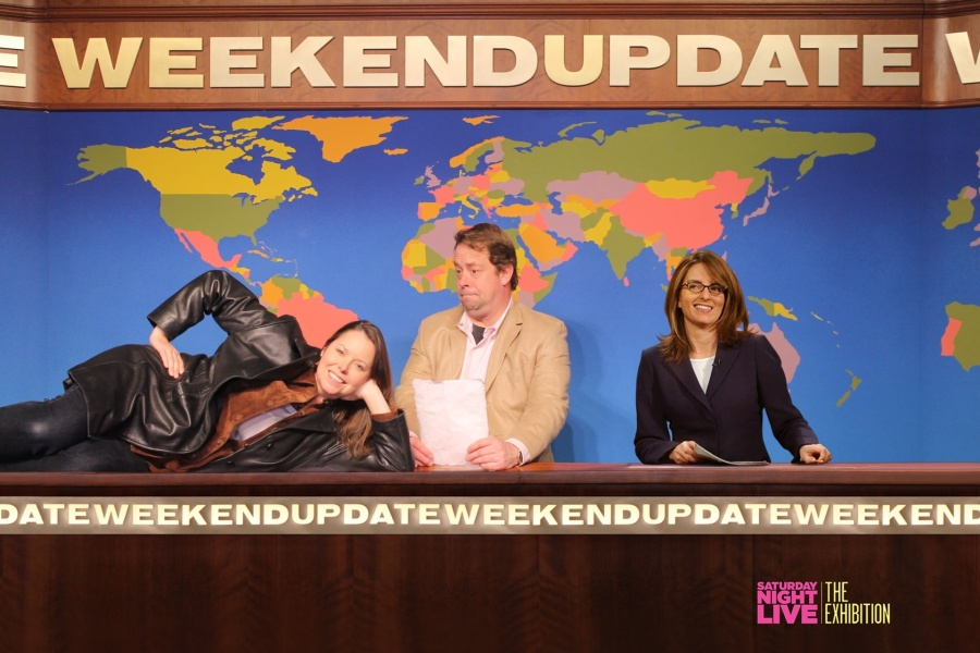 SNL's Weekend Update set with a superimposed Tina Fey