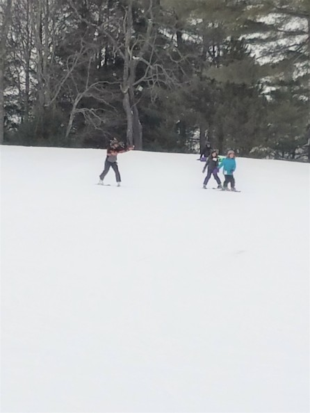 The instructor went down the slope with my kids to correct them along the way