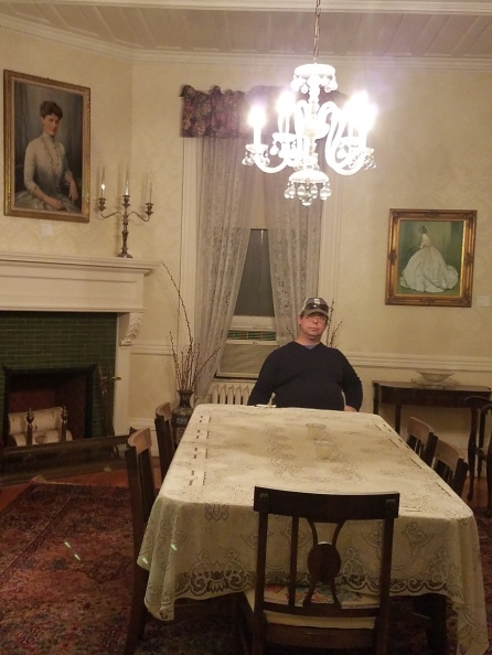 My husband looks a bit out of place amongst the white lace tablecloth, silver tea sets, crystal chandeliers, and portraits of women in flouncy dresses