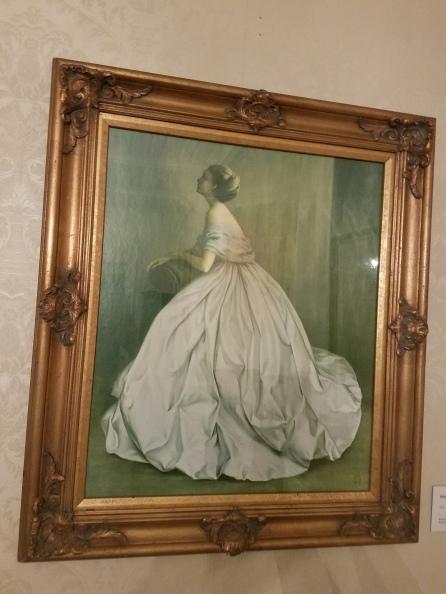 A gorgeous art work of a woman in a flouncy dress