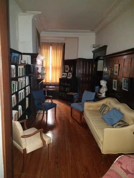 The library with the parlor in the rear by the window
