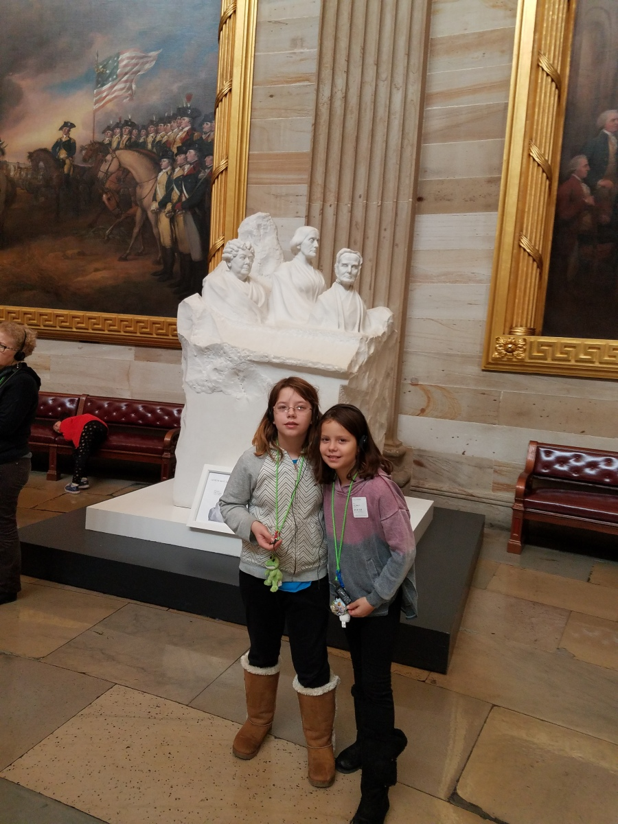 My daughters in the Capitol Building rotunda with Portrait Monument depicting Susan B. Anthony, Lucretia Mott, and Elizabeth Cady Stanton, sculpted by Adelaide Johnson in 1921.