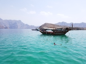 Floating in the Strait of Hormuz, Musandam Peninsula of Oman photo by Anastasia Mills Healy