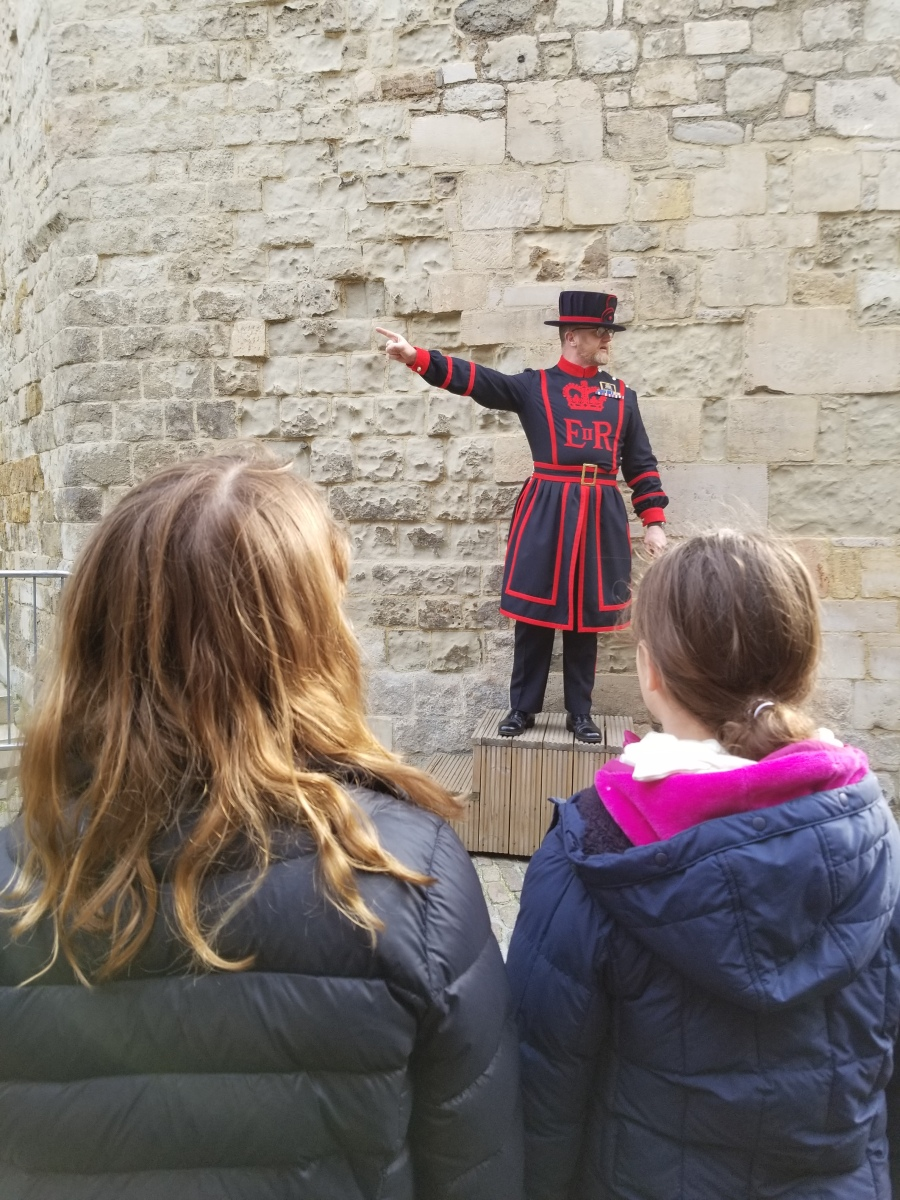 Children listening to a Beefeater on a Tower of London tour. Photo by Anastasia Mills Healy.